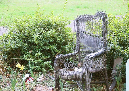 old woven chair in a garden