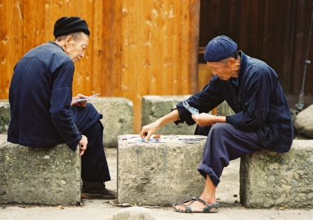 Elderly men playing cards