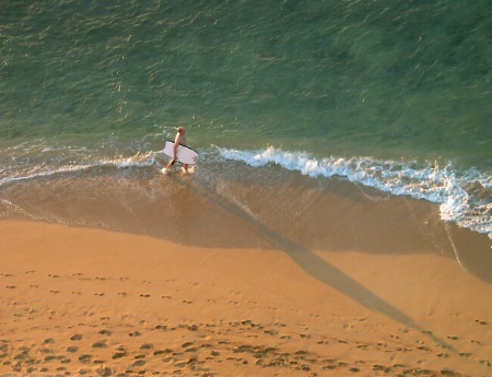 Long Shadow of a Surfer