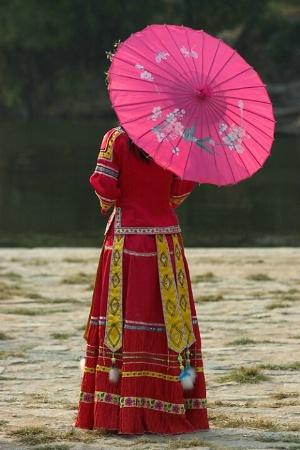 *Woman in traditional costume, Yangshou, China