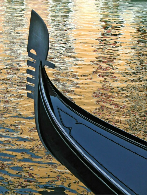 Gondola on golden reflections