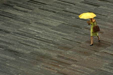 Woman With Yellow Umbrella In The Rain