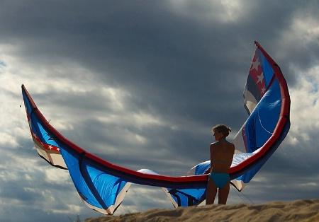 Kite Surfer under Stormy Sky