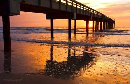 Sunrise Through the Pier
