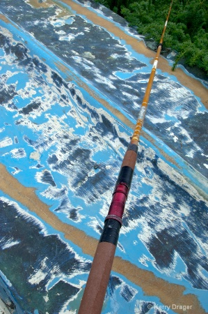 Old Multi-Painted Boat & Fishing Pole