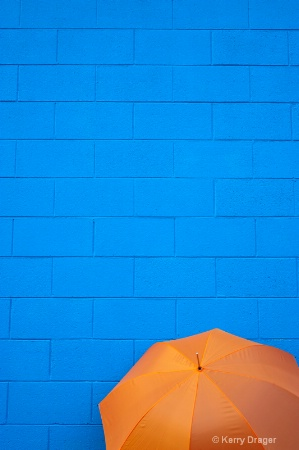 Orange Umbrella and Blue Wall