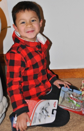 EDY  OPENING  HIS  CHRISTMAS  GIFTS