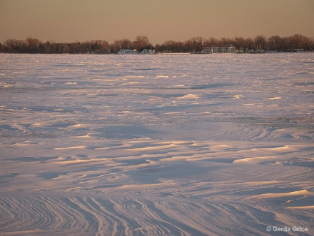 Snow Patterns at Sunset on Frozen over Lake