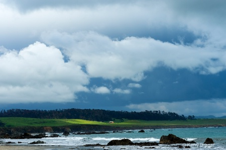 Coast and Storm Clouds
