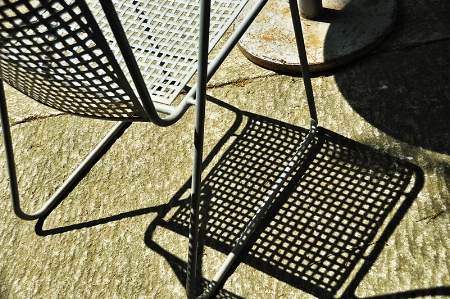 A CHAIR AND ITS SHADOW