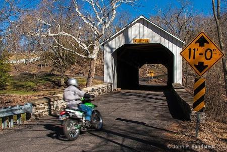 Cycling Through a Covered Bridge