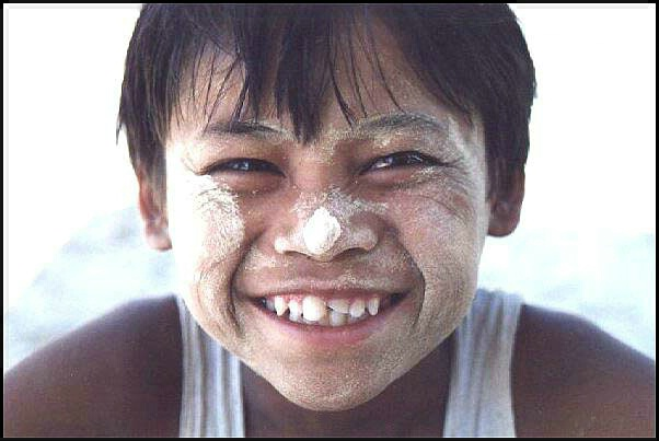 Burmese boy smeared with Thanaka paste