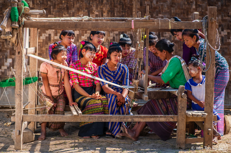 Weaving with wooden loom at village