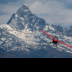 © Magdalene Teo PhotoID # 15802829: Red Plane at Himalayan Mountain Range