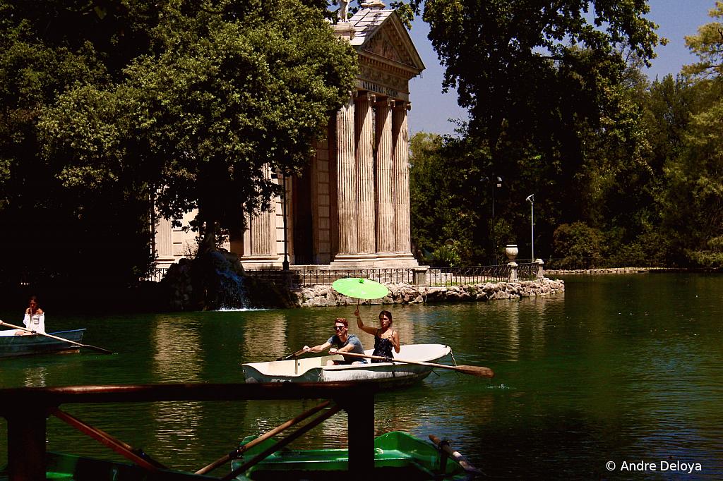 Roman Romance under a green umbrella.