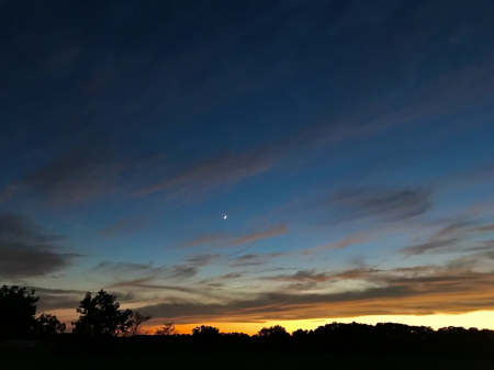Crescent Moon and Venus hanging in blue