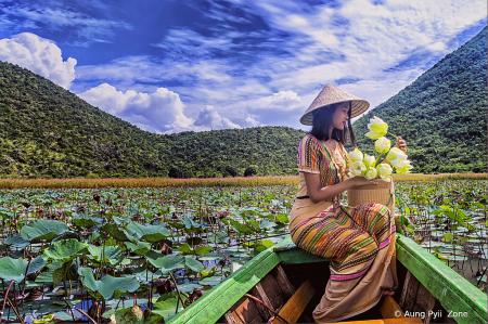 young girl in white lotus lake
