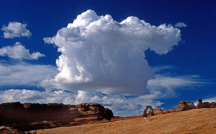 Cumulus Clouds Over Delicate Arch
