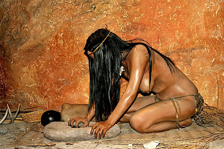 Ancient-woman-using-grinding stone