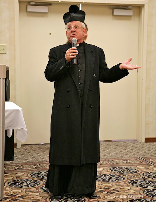 David Scarbo as Father Guido