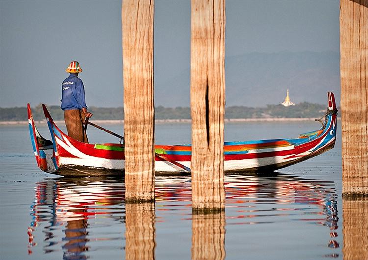 U Bein Bridge Boater behind posts, Myanmar (Burma)