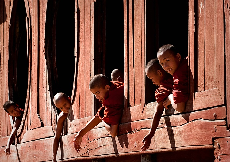 Young Monks hanging out windows, Myanmar (Burma)