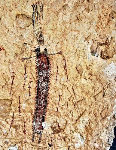 Anthropomorph encircled with log pole