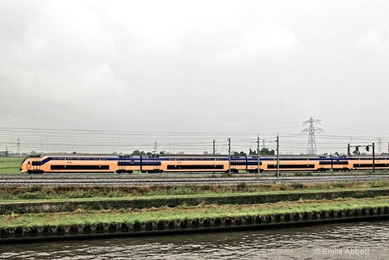 Commuter train along side of Kanaal