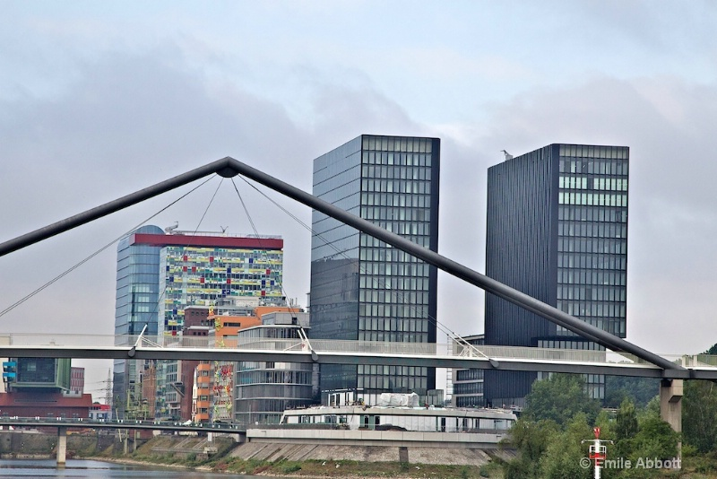 Cologne bridge framing multi-colored windows