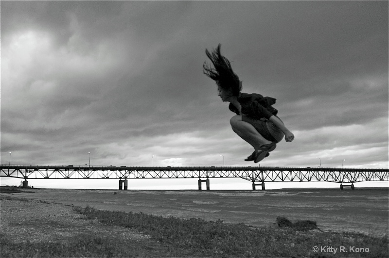 Yumiko Jumping Over the Mackinaw Island Bridge