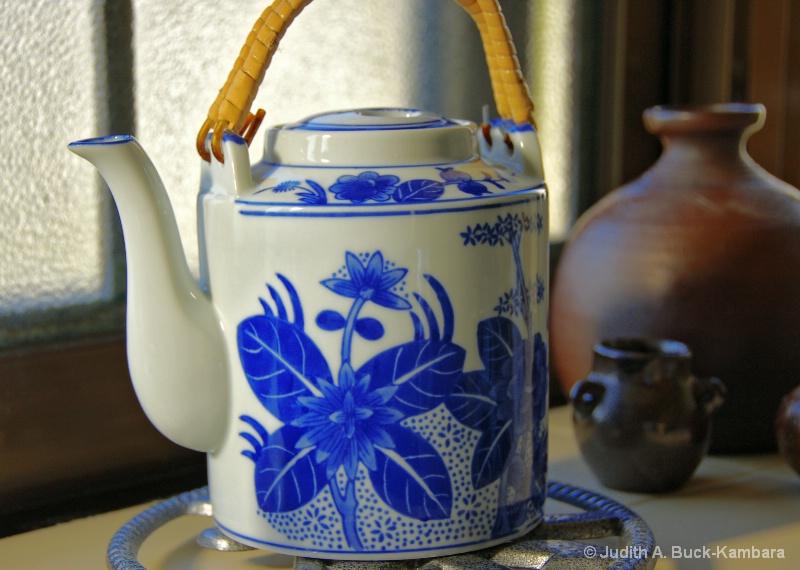 teapot in a windowsill