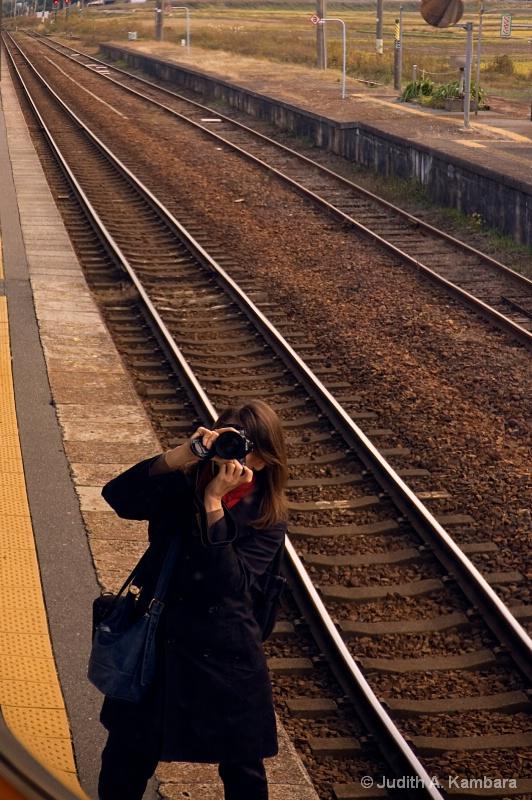Self portrait in a train platform mirror