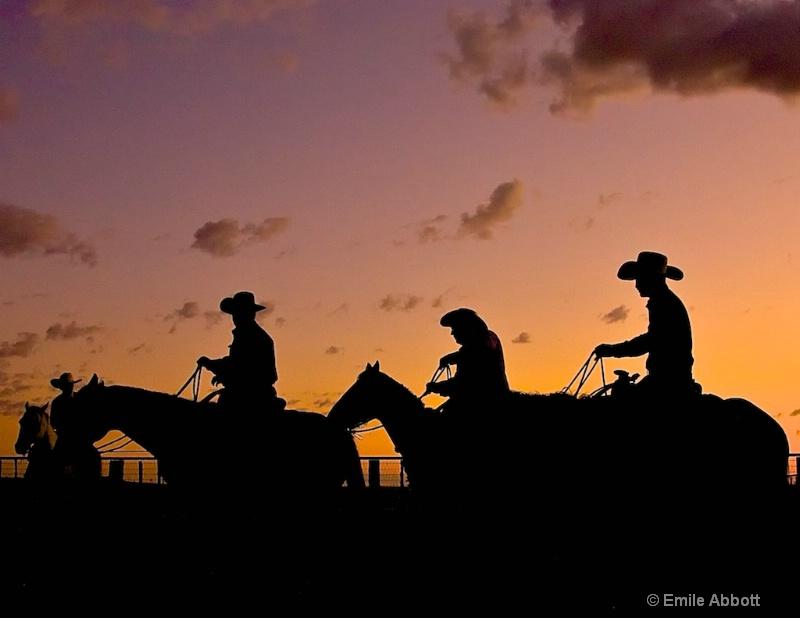 Cowboy silhouettes at dawn