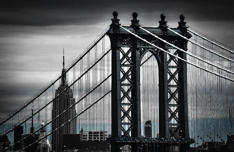 The Empire State though Manhattan Bridge