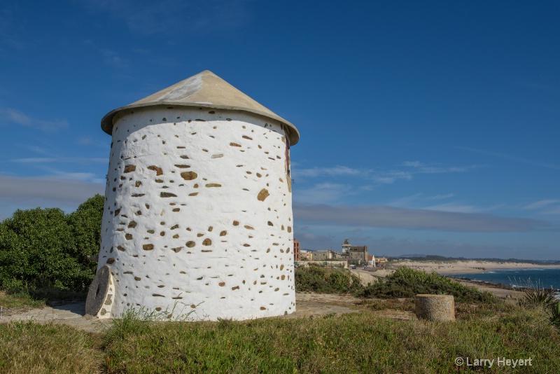 Old Windmill on Apulia Beach, Portugal