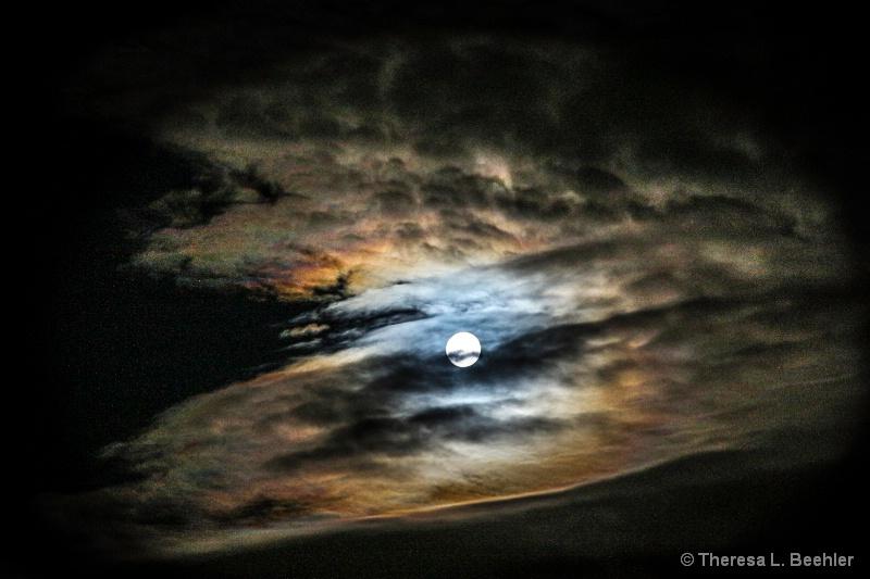 Moon rising through the storm