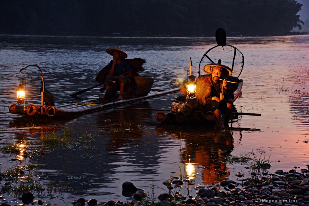Chinese man fishing with cormorants bird