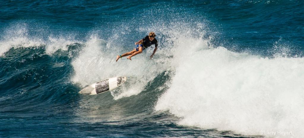 Surfing at Ho'okipa Beach, Maui
