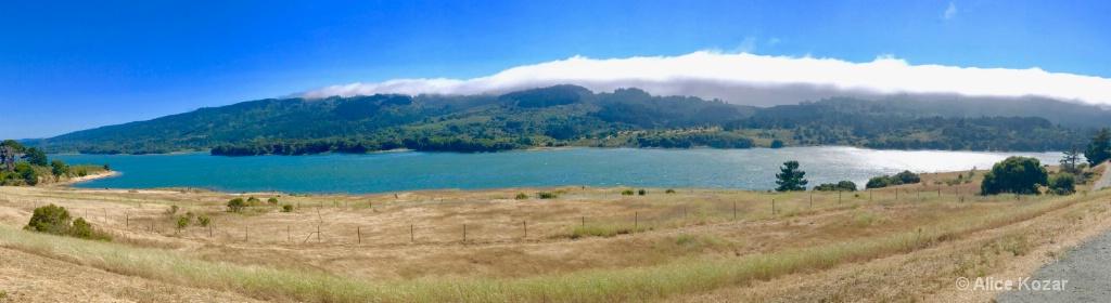 Panoramic Fog Arching Toward Reservoir
