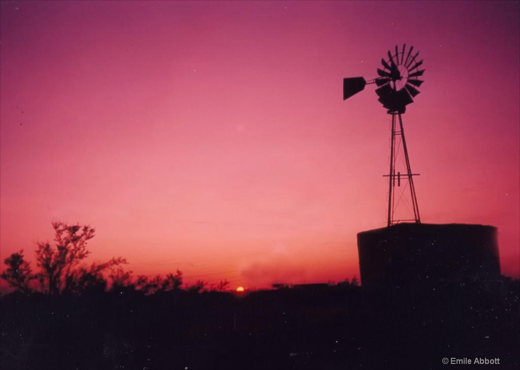 Texas tank and Windmill at sundown