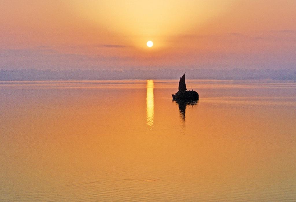 Serene sunset time at Ganges river.