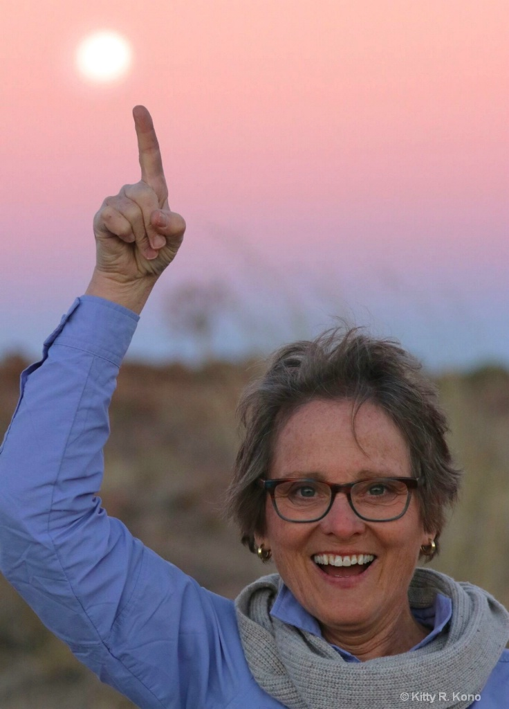 Kitty in Namibia Pointing to Full Moon