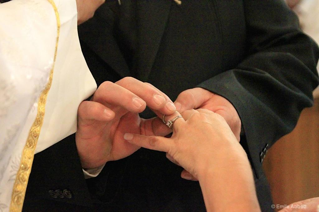 Groom placing ring