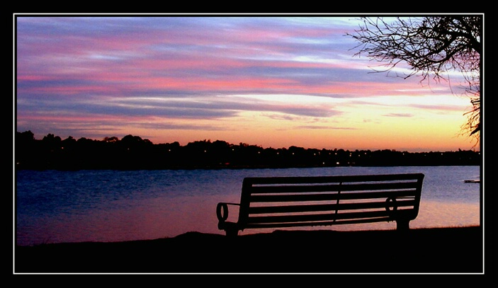 a bench-lake sunset