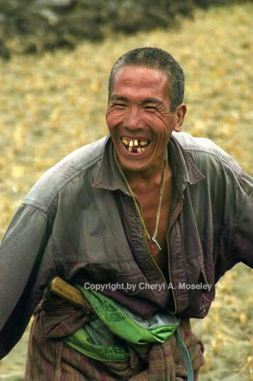 Bhutan farmer plowing, smiling, 14-4 - ID: 362421 © Cheryl  A. Moseley