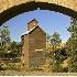 2Old Grain Elevator Framed by Bridge - ID: 1111153 © John Tubbs