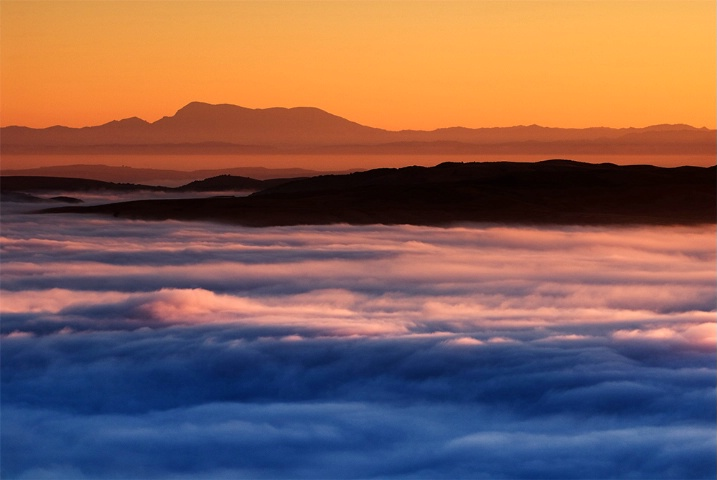 Sunrise over blanket of fog