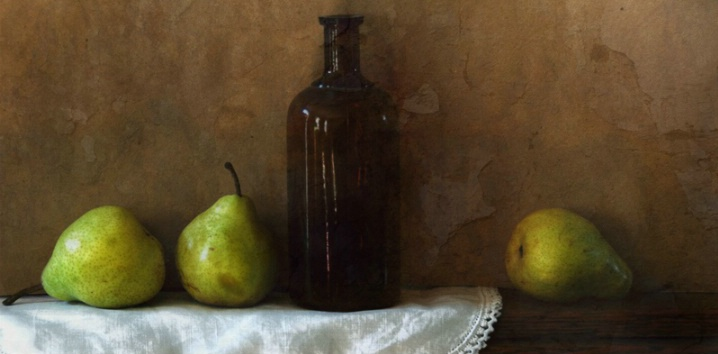 Three pears with brown bottle