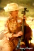 Cellist on a Brea...