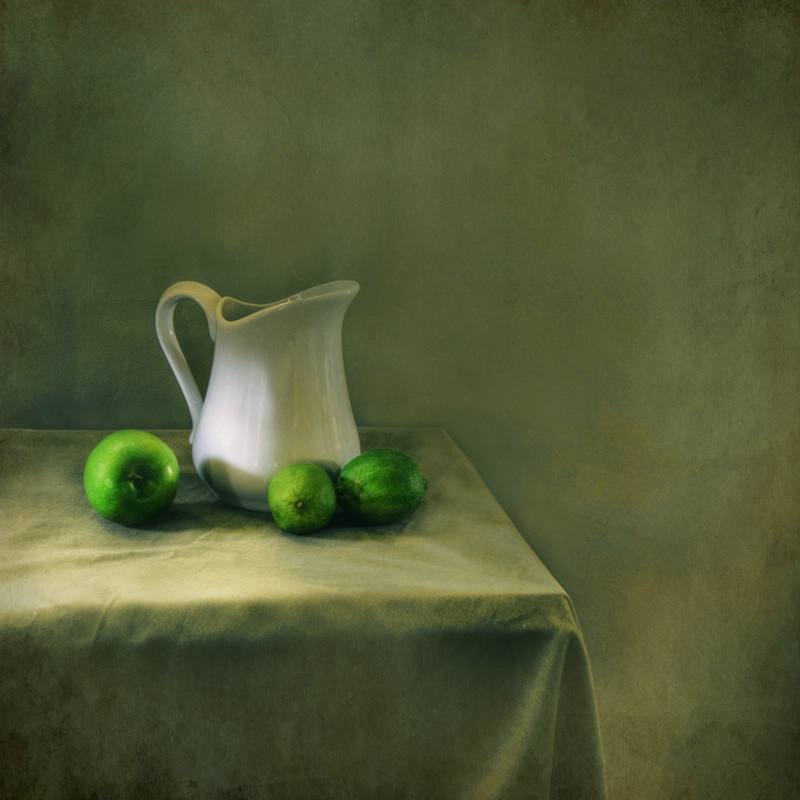 Still life with apple and limes